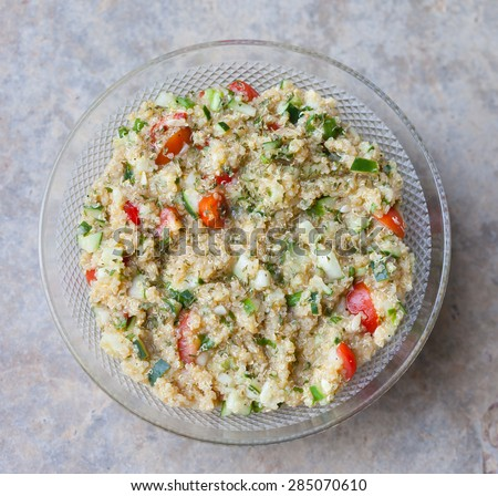 Overhead view of a bowl of fresh, homemade quinoa tabouli - stock photo