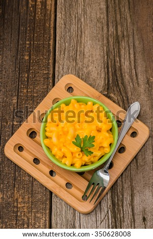 Overhead view of a bowl of macaroni and cheese. - stock photo