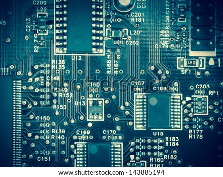 Overhead view of a circuit board, blue toning - stock photo