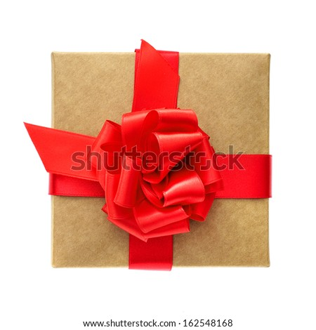 overhead view of a gift with a red satin ribbon bow on a white background  - stock photo