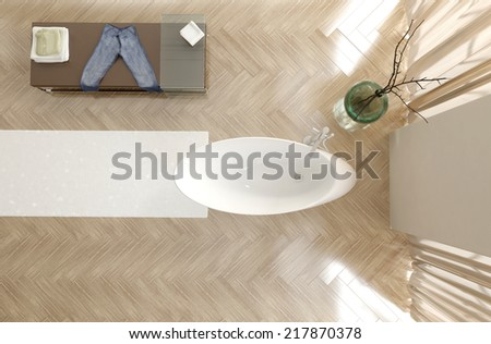 Overhead view of a modern bathroom interior with a contemporary oval white bathtub, herringbone parquet floor and cabinet with double volume height and tall windows - stock photo