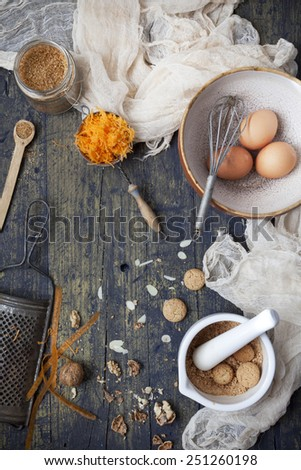 overhead view of a wooden table with ingredients  for preparing a carrot cake - stock photo