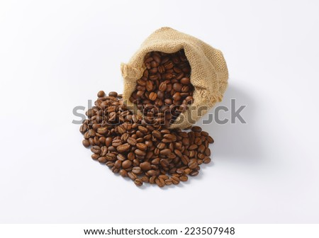 overhead view of burlap bag with roasted coffee - stock photo