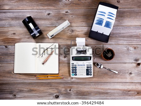 Overhead view of business desktop with supplies and objects from the past.  - stock photo