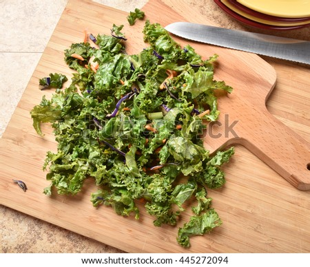 Overhead view of chopped kale, carrots and cabbage for salad - stock photo