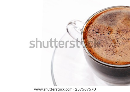 Overhead view of coffee with foam, close up, macro, in glass cup, Coffee background, Coffee foam texture - stock photo