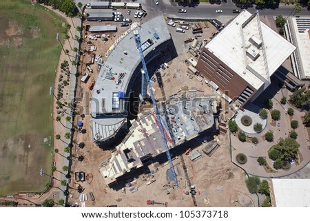 Overhead view of construction site with large crane - stock photo