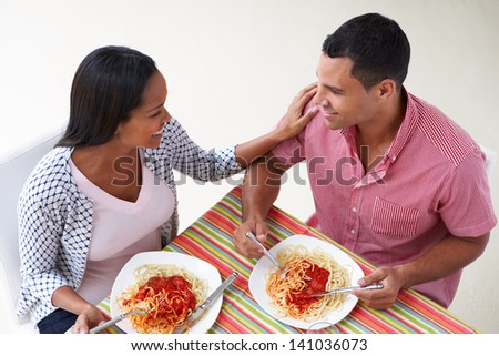 Overhead View Of Couple Eating Meal Together