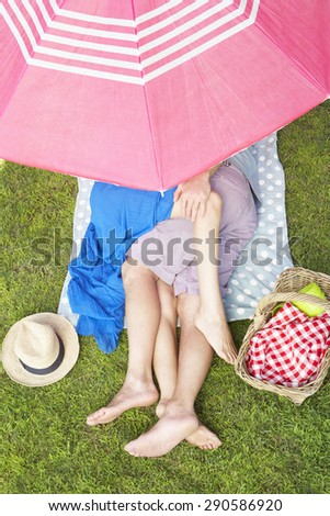 Overhead View Of Couple Enjoying Picnic Together - stock photo