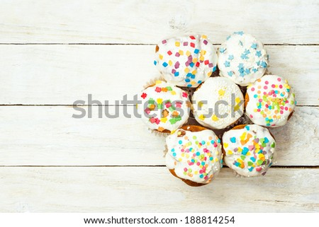 Overhead view of Easter cupcakes on white wooden background with copy space - stock photo