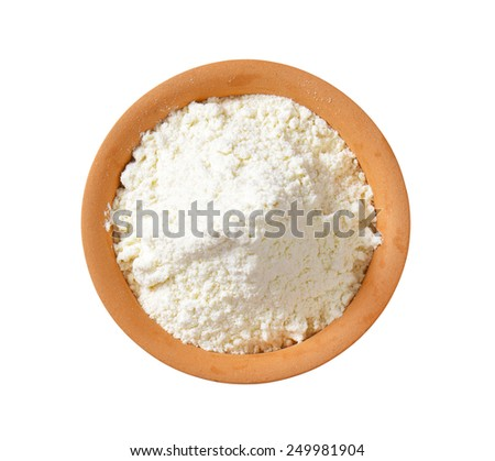 overhead view of finely ground flour in terracotta bowl - stock photo