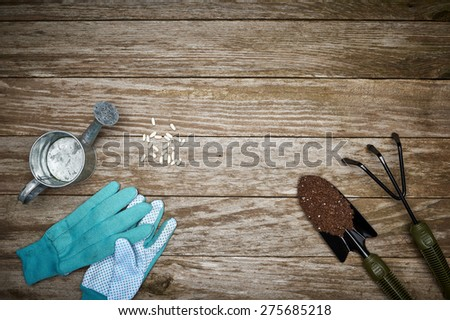 overhead view of gardening tools on a deck - stock photo