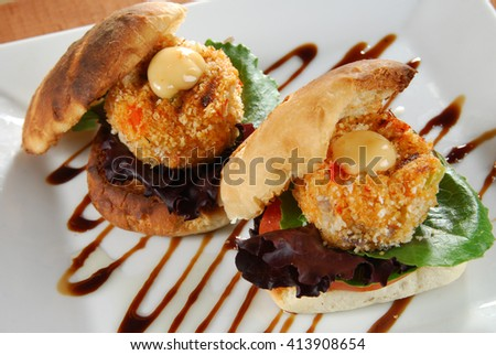 Overhead view of gourmet crabcake sandwiches - stock photo