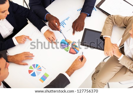 overhead view of group business people having meeting together - stock photo