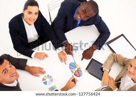 overhead view of group of business people having meeting together - stock photo
