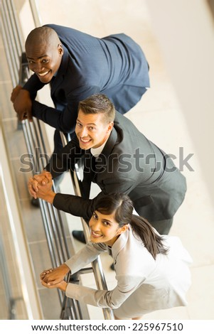 overhead view of happy businesspeople looking up - stock photo