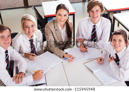 overhead view of high school teacher and students in classroom - stock photo