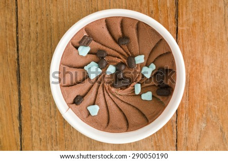 Overhead view of  homemade Chocolate Mint Italian ice cream tub on wooden background - stock photo