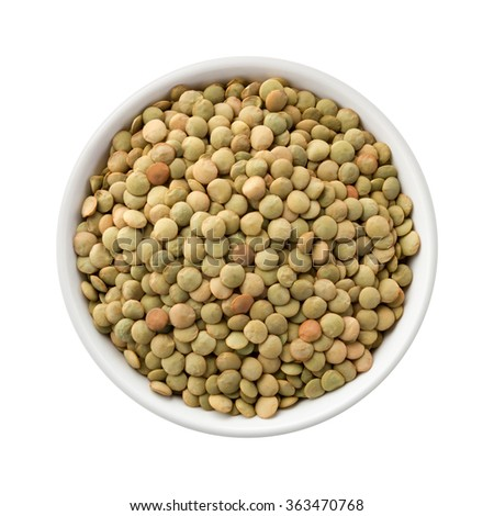 Overhead View of Lentils in a Ceramic Bowl. The image is a cut out, isolated on a white background, with a clipping path. - stock photo