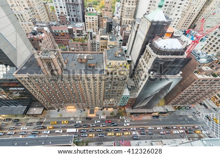 Overhead view of Manhattan buildings and streets at dusk. New York aerial landscape. - stock photo