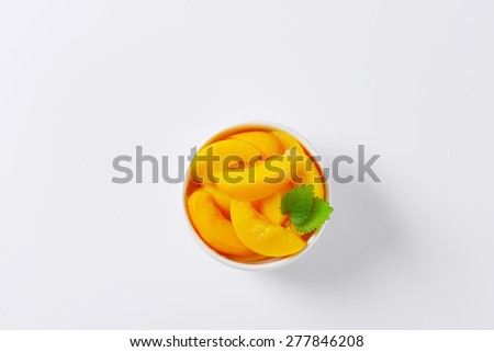 overhead view of peach compote served in the bowl - stock photo