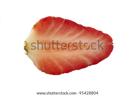 Overhead view of slice of strawberry on plain background - stock photo