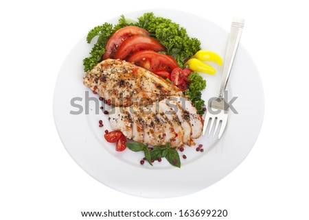 Overhead view of Spicy chicken breasts served on a plate with a clipping path. - stock photo
