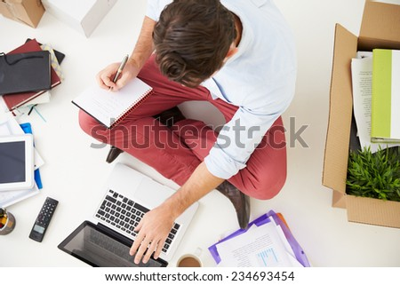 Overhead View Of Start Up Business Moving Into Office - stock photo