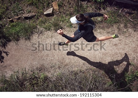 overhead view of trail runner running on mountain - stock photo