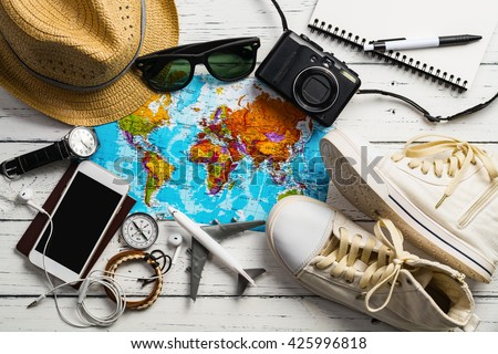 Overhead view of Traveler's accessories, Essential items of traveler, Travel concept background - stock photo