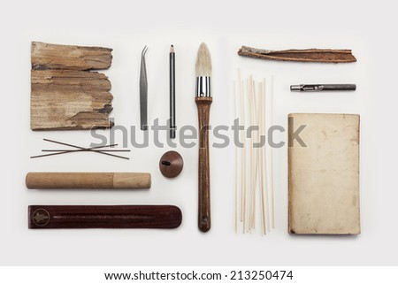 Overhead view of wood materials placed on white background. - stock photo