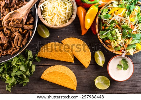 overhead view on authentic mexican street taco with beef and vegetables - stock photo