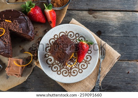 overhead view on chocolate torte cake served on plate - stock photo