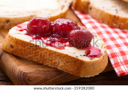 Overhead view on healthy breakfast with strawberry jam. Berries, summer fruit on wooden table. Healthy lifestyle concept, Top view horizontal, Selective focus