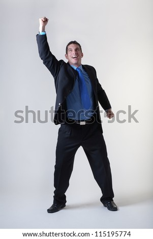 overjoyed business man expring his happiness - stock photo