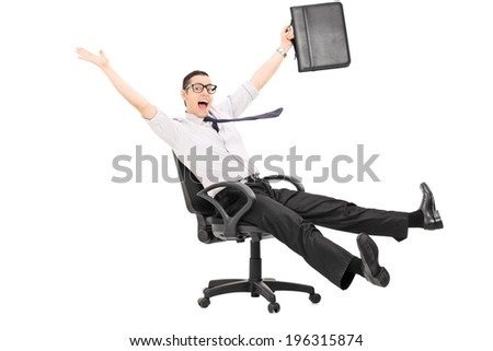 Overjoyed businessman riding in an office chair isolated on white background - stock photo