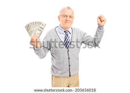 Overjoyed senior holding cash and gesturing happiness isolated on white background - stock photo