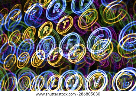 Overlapping colorful neon typewriter keys - stock photo