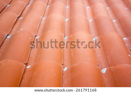 Overlapping red clay tiles set in rows of waves, background - stock photo