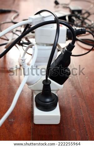 Overloaded Power Plug - stock photo