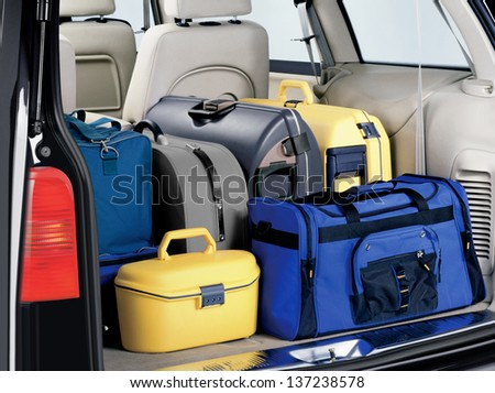 overloaded trunk of a car leaving for the travel - stock photo