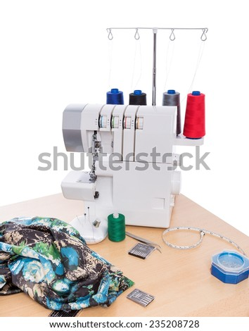 Overlock sewing machine on the table. Sewing Accessories. - stock photo