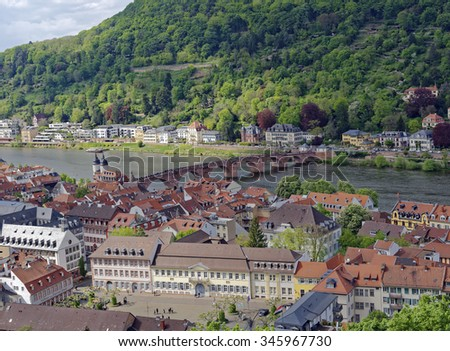 Overlook from the Heidelberg Castle ruins of the old city and the medieval bridge across the River Neckar in Baden-Wurttemberg, Germany - stock photo