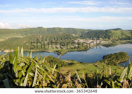 Overlook of Lagoa das sete cidades (Lake of the Seven Cities), a volcanic crater lake, and its bridge in between the two lagoons - stock photo