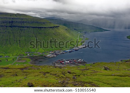 Overlook on a stormy day of fish processing industry in a sea fiord in the Faroe Islands