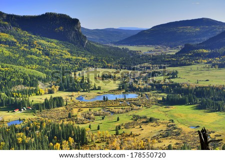 overlook over colourful mountains of Colorado during foliage season - stock photo