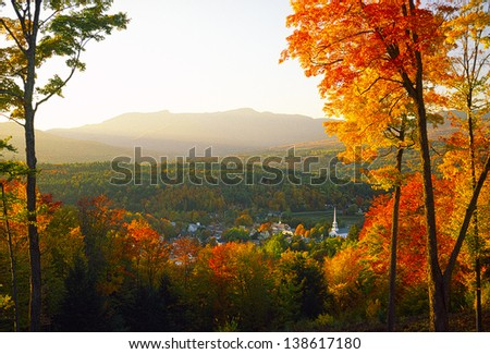 Overlooking a peaceful New England community church and village in the autumn., Stowe, Vermont, USA - stock photo