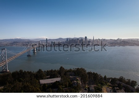Overlooking San Francisco cityscape and bay bridge - stock photo