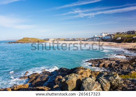 Overlooking the golden sandy Porthmeor Beach St Ives Cornwall England with The Island headland in the distance.