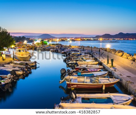 Overlooking the harbour at night. Faliraki Rhodes Dodecanese Greece Europe